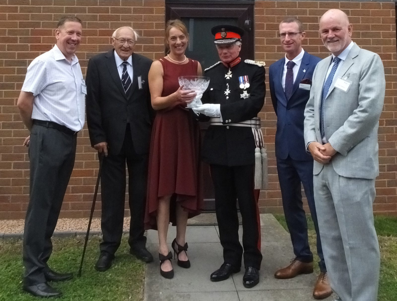"""Kudos Blends, based in Cleobury Mortimer, Shropshire celebrate a Queen's Award for Enterprise in the category of International Trade. The award was presented by Sir Algernon Heber-Percy, Lord Lieutenant of Shropshire at a champagne reception. Pictured here, Dinnie Jordan (founder and MD) accepts the award, accompanied by honoured guests, the very closest """"Friends of Kudos""""."""